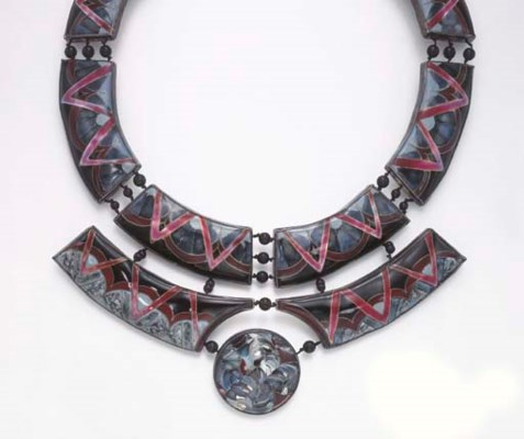 A MULTI-COLOR ENAMEL, ONYX AND