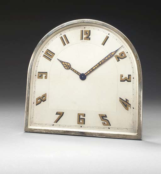 AN ART DECO SILVER DESK CLOCK,
