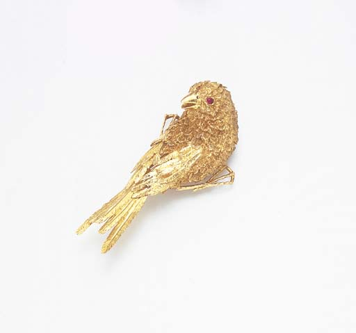 A RUBY AND GOLD BIRD BROOCH, B