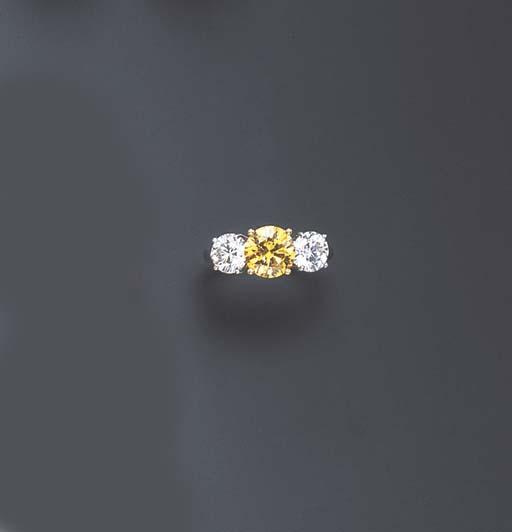 A COLORED DIAMOND AND DIAMOND RING