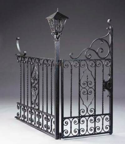 A BLACK-PAINTED WROUGHT-IRON G