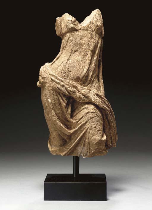 A GREEK LIMESTONE DRAPED FEMAL