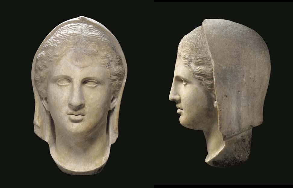 A GREEK MARBLE VEILED HEAD OF