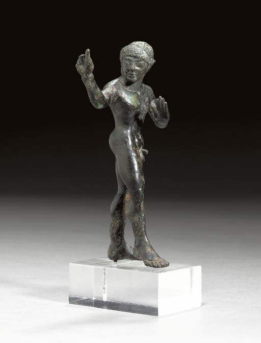 AN ETRUSCAN BRONZE FIGURE OF A