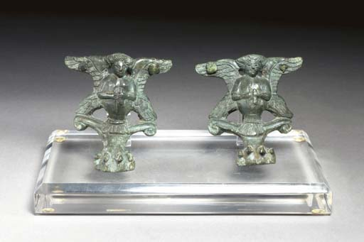 TWO ETRUSCAN BRONZE CISTA FEET