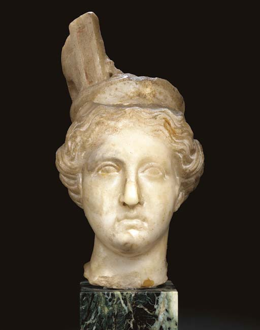 A ROMAN MARBLE HEAD OF TYCHE