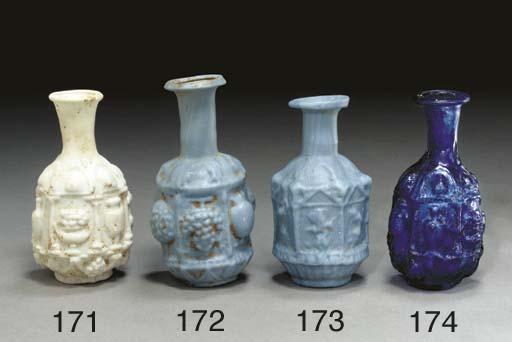 A ROMAN GLASS HEXAGONAL BOTTLE