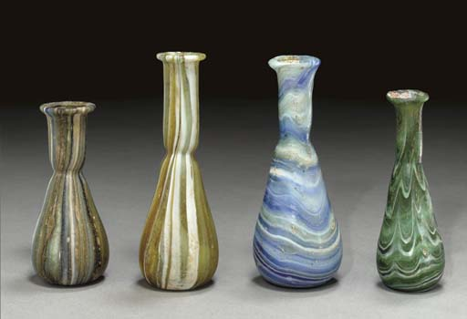 FOUR ROMAN MARBLED GLASS UNGUE