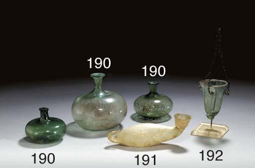 THREE ROMAN GLASS BOTTLES