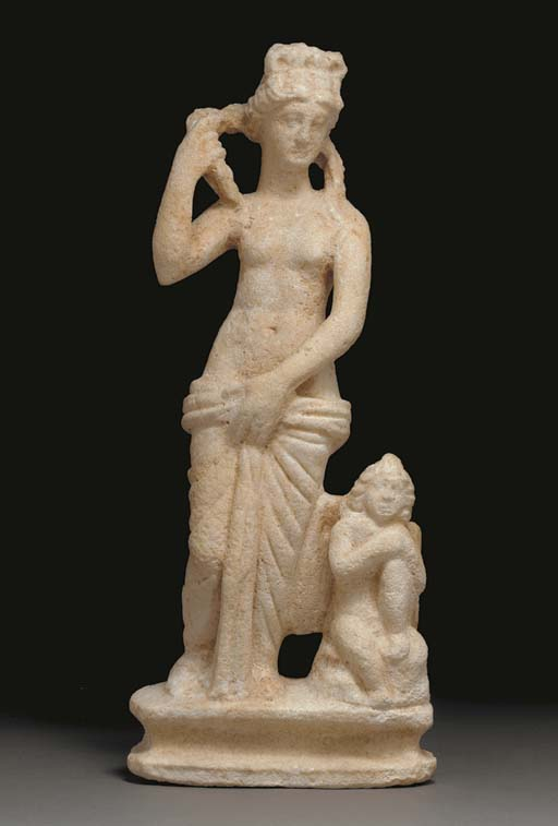 A ROMAN MARBLE GROUP WITH VENU