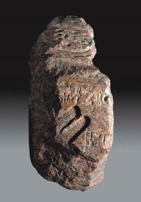 AN EGYPTIAN RED GRANITE FRAGME