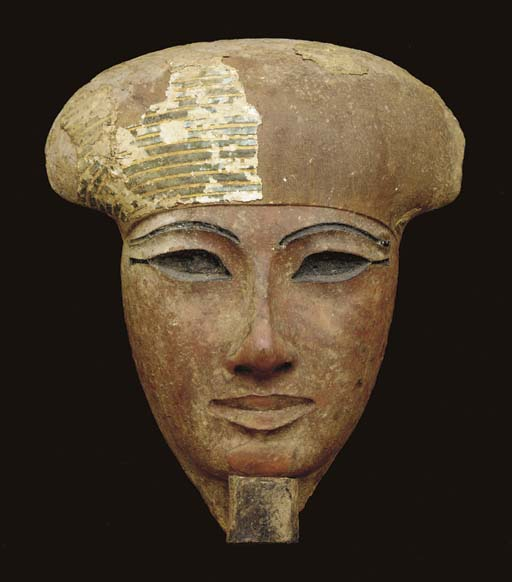 AN EGYPTIAN WOOD MASK FROM A S