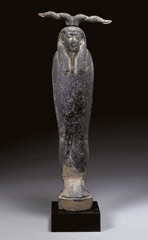 AN EGYPTIAN WOOD FIGURE OF PTA