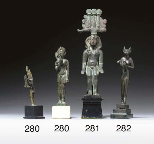 AN EGYPTIAN BRONZE FIGURE OF B