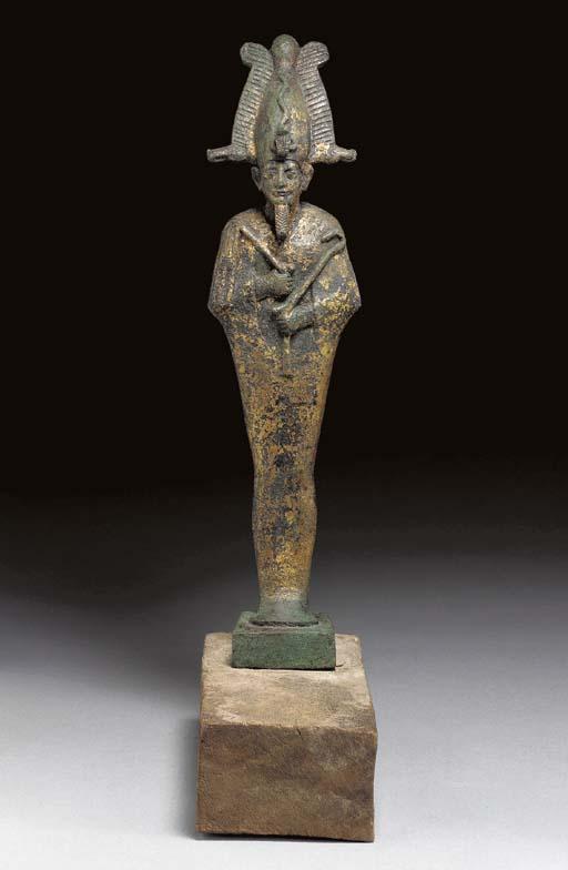 AN EGYPTIAN GILT BRONZE OSIRIS