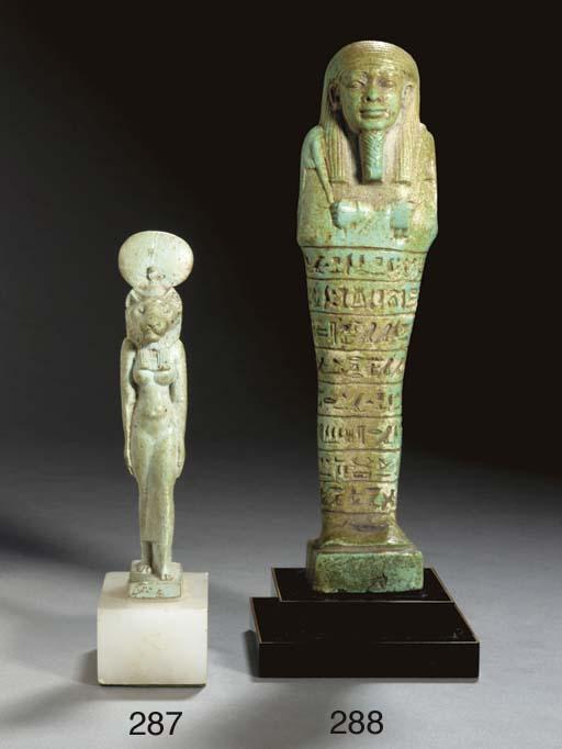 AN EGYPTIAN FAIENCE FIGURE OF