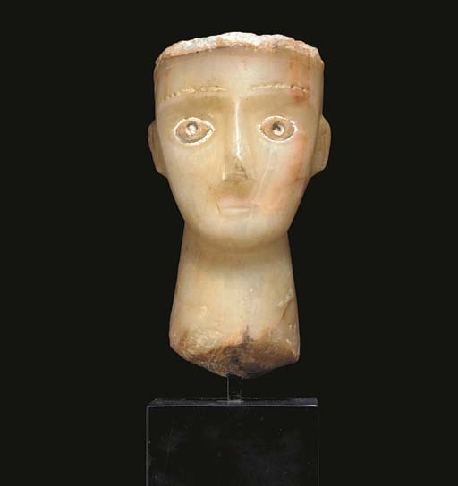 A SOUTH ARABIAN ALABASTER HEAD