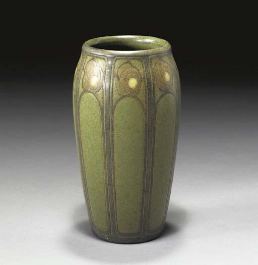 AN INCISED AND GLAZED EARTHENW