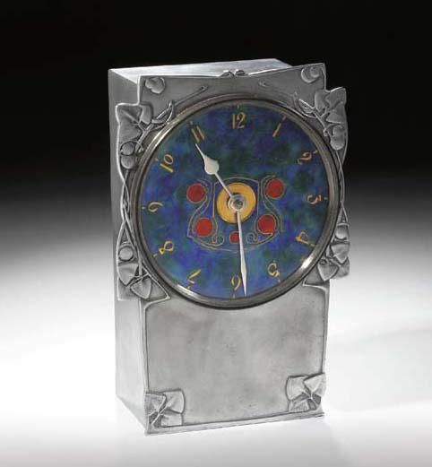AN ENAMELED PEWTER CLOCK