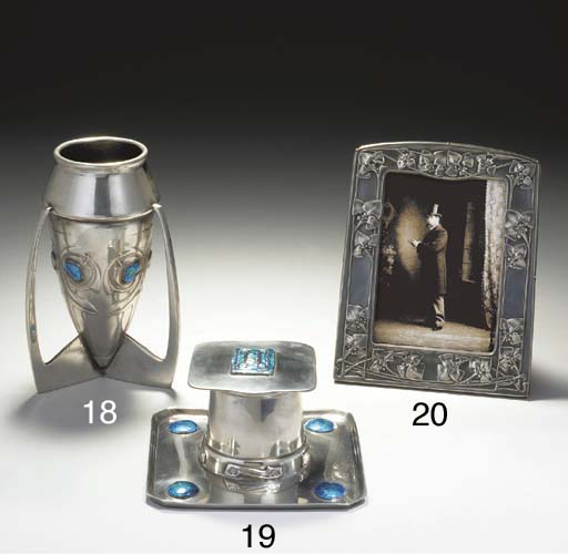 AN ENAMELED PEWTER INKWELL