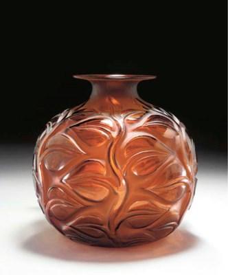 'SOPHORA', AN AMBER GLASS VASE