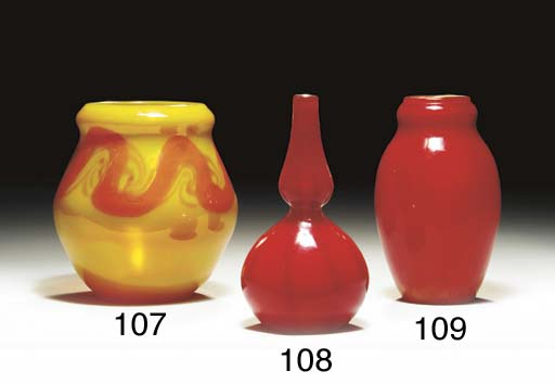 A RED FAVRILE GLASS VASE