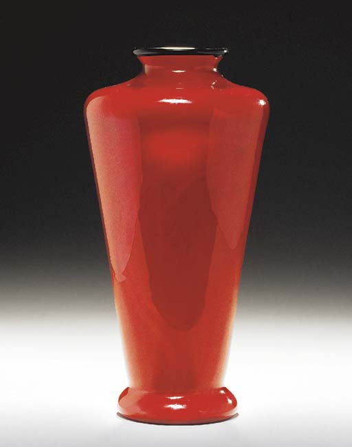 A RED FAVRILE GLASS VASE WITH