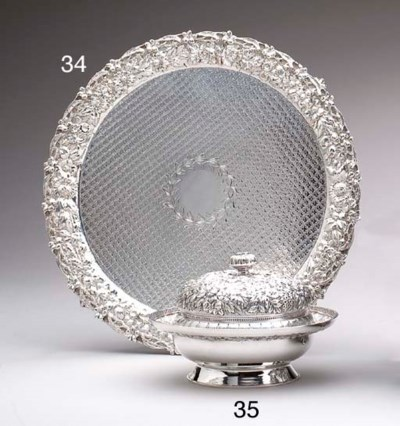 A SILVER COVERED BUTTER DISH