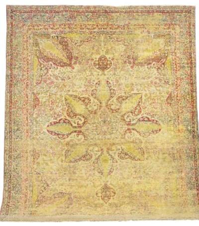 A LAVAR KIRMAN CARPET,