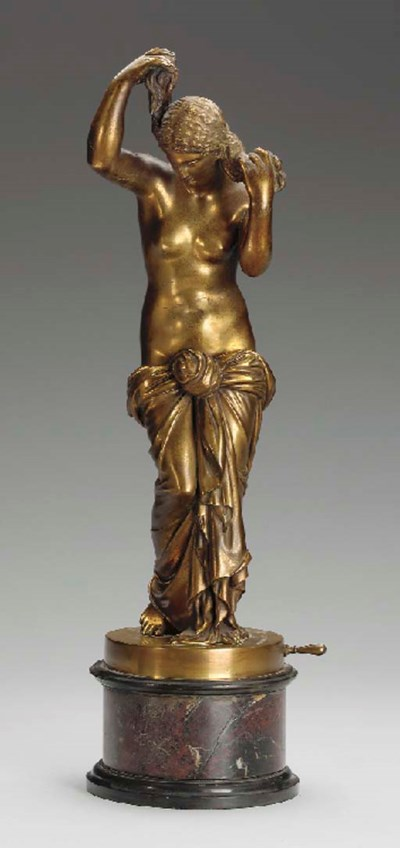 A gilt-bronze figure of a bath