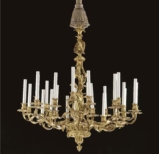 A Louis XV style gilt-metal twenty-four light chandelier,