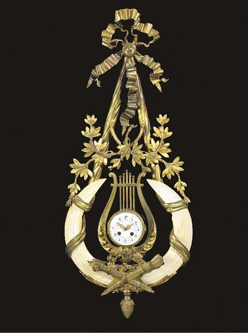 A Louis XVI style ormolu and ivory cartel clock**,