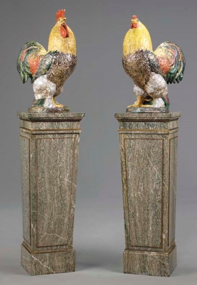 A PAIR OF GLAZED TERRACOTTA MO