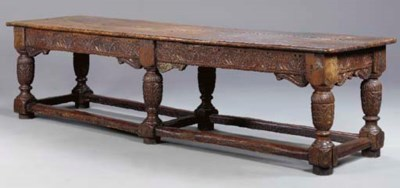 A JACOBEAN STYLE CARVED OAK RE