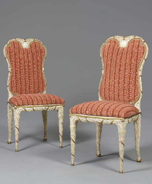 A SET OF TEN ITALIAN ROCOCO STYLE PARCEL-GILT, GREEN AND WHITE-PAINTED DINING CHAIRS,