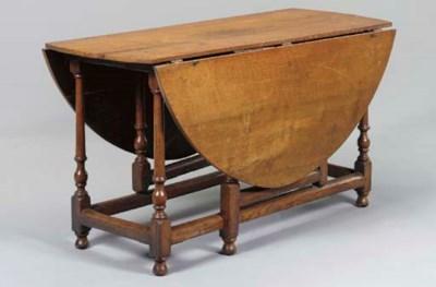 AN ENGLISH OAK GATE-LEG TABLE,