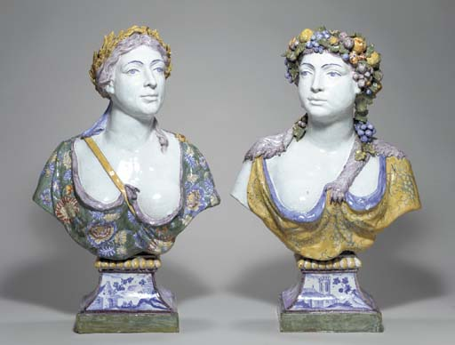 A PAIR OF FAIENCE BUSTS EMBLEM