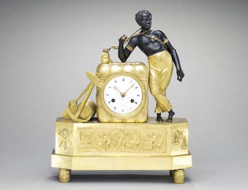 AN EMPIRE ORMOLU AND PATINATED