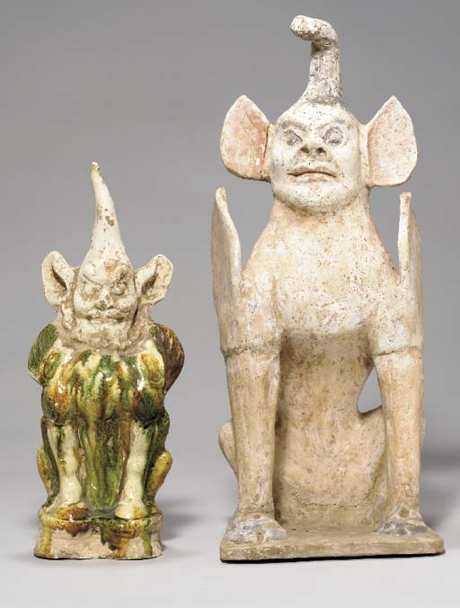 TWO POTTERY FIGURES OF EARTH S