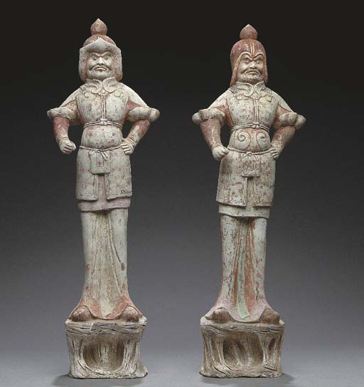 A PAIR OF PAINTED POTTERY FIGU