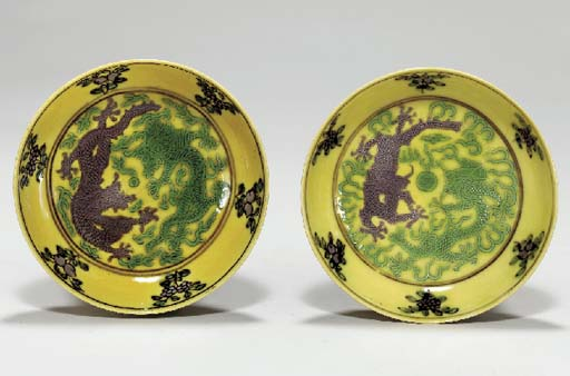 TWO AUBERGINE-DECORATED YELLOW