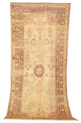 AN EAST TURKESTAN CARPET,
