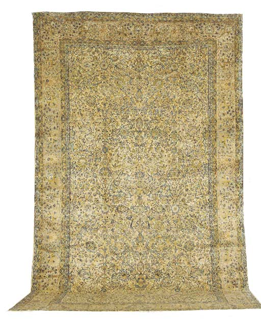 A KIRMAN CARPET,