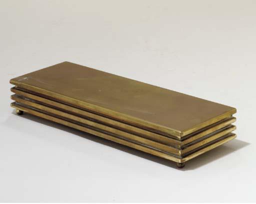 A BRASS CIGARETTE BOX,