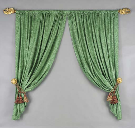 A SET OF CURTAIN TIE BACKS AND
