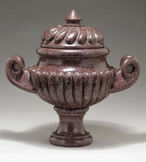 A RED PORPHYRY COVERED URN,