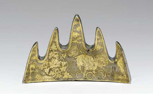 A RARE BRASS-DECORATED PEWTER