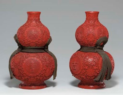 A PAIR OF CARVED RED LACQUER D