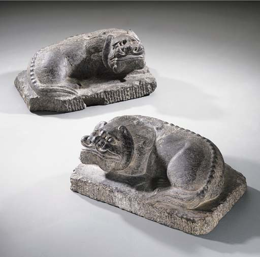 A PAIR OF GREY STONE FIGURES O