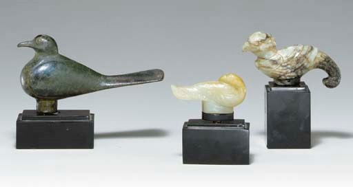 A BRONZE BIRD-FORM FINIAL AND